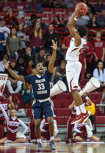Arkansas Razorbacks guard Jimmy Whitt (24) with a shot during a basketball game between Arkansas and Charleston Southern on November 20, 2015.    (Alan Jamison, Nate Allen Sports Service)