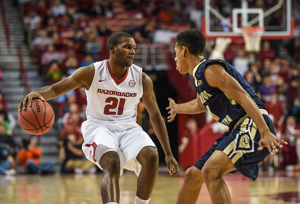 Arkansas Razorbacks guard Manuale Watkins (21) at point during a basketball game between Arkansas and Charleston Southern on November 20, 2015.    (Alan Jamison, Nate Allen Sports Service)