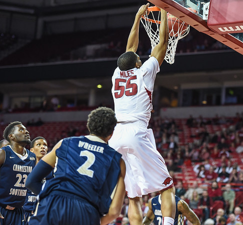 Arkansas Razorbacks forward Keaton Miles (55) with a dunk during a basketball game between Arkansas and Charleston Southern on November 20, 2015.    (Alan Jamison, Nate Allen Sports Service)