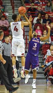 Arkansas Razorbacks guard Jabril Durham (4) with a shot during a basketball game between Arkansas and Northwestern State on December 1, 2015.    (Alan Jamison, Nate Allen Sports Service)