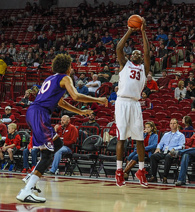 Arkansas Razorbacks forward Moses Kingsley (33) with a shot during a basketball game between Arkansas and Northwestern State on December 1, 2015.    (Alan Jamison, Nate Allen Sports Service)