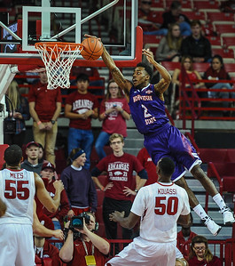 Northwestern State Demons guard Ta'Jon Welcome (2) comes up short on a shot during a basketball game between Arkansas and Northwestern State on December 1, 2015.    (Alan Jamison, Nate Allen Sports Service)