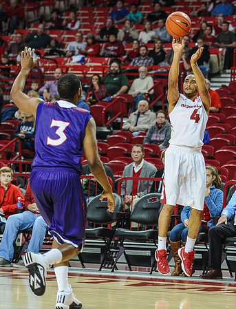 Arkansas Razorbacks guard Jabril Durham (4) with a shot during a basketball game between Arkansas and Northwestern State on December 1, 2015.    (Alan Jamison, Nate Allen Sports Service)