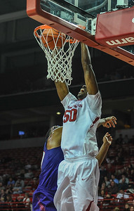 Arkansas Razorbacks center Willy Kouassi (50) with a dunk during a basketball game between Arkansas and Northwestern State on December 1, 2015.    (Alan Jamison, Nate Allen Sports Service)