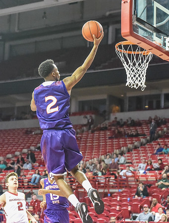 Northwestern State Demons guard Ta'Jon Welcome (2) shoots during a basketball game between Arkansas and Northwestern State on December 1, 2015.    (Alan Jamison, Nate Allen Sports Service)