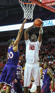 Arkansas Razorbacks center Willy Kouassi (50) goes up for a dunk during a basketball game between Arkansas and Northwestern State on December 1, 2015.    (Alan Jamison, Nate Allen Sports Service)