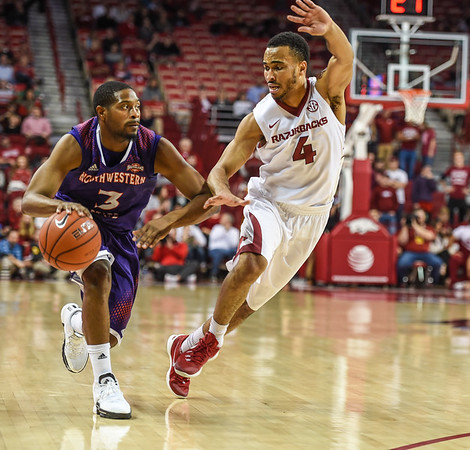 Arkansas Razorbacks guard Jabril Durham (4) defends against Northwestern State Demons guard Devonte Hall (3) during a basketball game between Arkansas and Northwestern State on December 1, 2015.    (Alan Jamison, Nate Allen Sports Service)