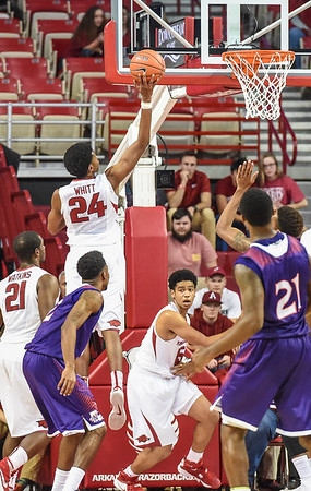 Arkansas Razorbacks guard Jimmy Whitt (24) with a layup during a basketball game between Arkansas and Northwestern State on December 1, 2015.    (Alan Jamison, Nate Allen Sports Service)