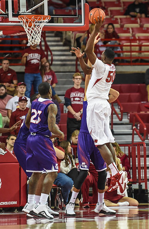 Arkansas Razorbacks center Willy Kouassi (50) with a shot during a basketball game between Arkansas and Northwestern State on December 1, 2015.    (Alan Jamison, Nate Allen Sports Service)