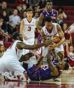 Arkansas Razorbacks guard Jabril Durham (4) fights for a ball during a basketball game between Arkansas and Northwestern State on December 1, 2015.    (Alan Jamison, Nate Allen Sports Service)