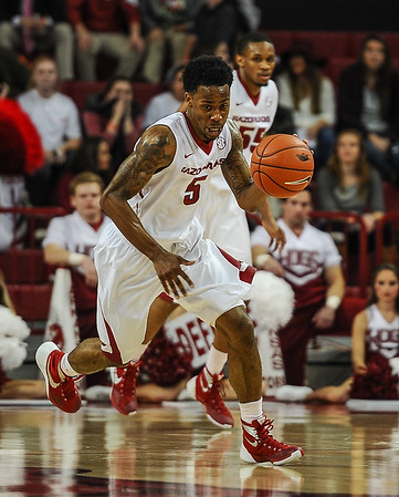 Arkansas Razorbacks guard Anthlon Bell (5) at point during a basketball game between Arkansas and Northwestern State on December 1, 2015.    (Alan Jamison, Nate Allen Sports Service)