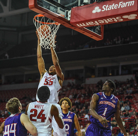 Arkansas Razorbacks forward Keaton Miles (55) after a dunk during a basketball game between Arkansas and Northwestern State on December 1, 2015.    (Alan Jamison, Nate Allen Sports Service)