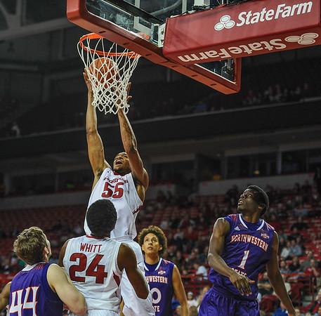 Arkansas Razorbacks forward Keaton Miles (55) after a dunk during a basketball game between Arkansas and Northwestern State on December 1, 2015.    (Alan Jamison, Nate Allen Sports Service)