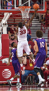 Arkansas Razorbacks forward Moses Kingsley (33) with a layup during a basketball game between Arkansas and Northwestern State on December 1, 2015.    (Alan Jamison, Nate Allen Sports Service)