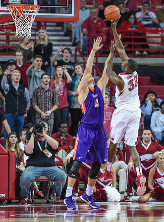 Arkansas Razorbacks forward Moses Kingsley (33) shoots  during a basketball game between Arkansas and Evansville on December 8, 2015.    (Alan Jamison, Nate Allen Sports Service)
