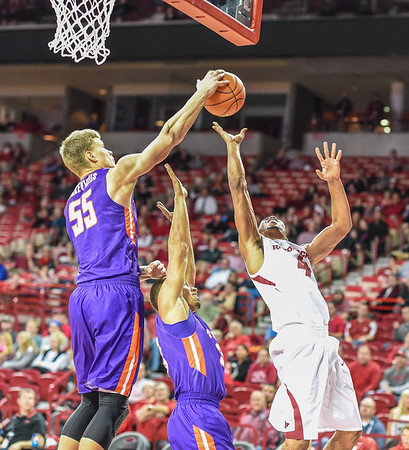 Evansville Aces center Egidijus Mockevicius (55) blocks the shot of Arkansas Razorbacks guard Jabril Durham (4) during a basketball game between Arkansas and Evansville on December 8, 2015.    (Alan Jamison, Nate Allen Sports Service)