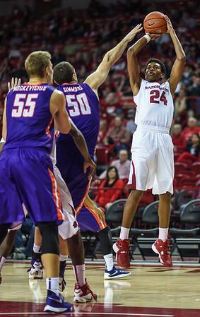 Arkansas Razorbacks guard Jimmy Whitt (24) shoots during a basketball game between Arkansas and Evansville on December 8, 2015.    (Alan Jamison, Nate Allen Sports Service)
