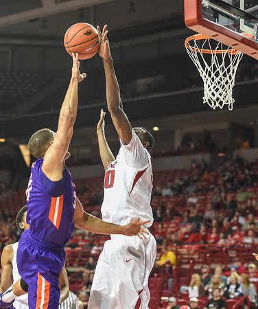 Arkansas Razorbacks center Willy Kouassi (50) with a block during a basketball game between Arkansas and Evansville on December 8, 2015.    (Alan Jamison, Nate Allen Sports Service)