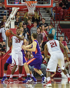 Arkansas Razorbacks forward Moses Kingsley (33) clears a rebound during a basketball game between Arkansas and Evansville on December 8, 2015.    (Alan Jamison, Nate Allen Sports Service)