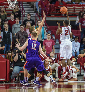 Arkansas Razorbacks guard Manuale Watkins (21) shoots  during a basketball game between Arkansas and Evansville on December 8, 2015.    (Alan Jamison, Nate Allen Sports Service)