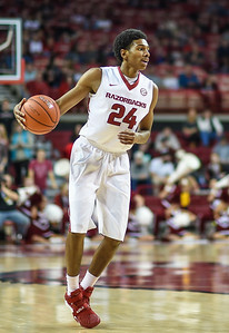 Arkansas Razorbacks guard Jimmy Whitt (24) at point during a basketball game between Arkansas and Evansville on December 8, 2015.    (Alan Jamison, Nate Allen Sports Service)