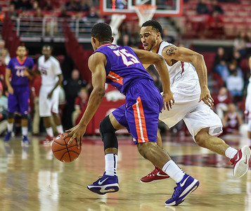 Arkansas Razorbacks guard Jabril Durham (4) guards Evansville Aces guard Duane Gibson (25) during a basketball game between Arkansas and Evansville on December 8, 2015.    (Alan Jamison, Nate Allen Sports Service)