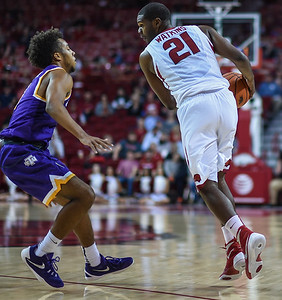 Arkansas Razorbacks guard Manuale Watkins (21) at point during a basketball game between Arkansas and Tennessee Tech on December 12, 2015.    (Alan Jamison, Nate Allen Sports Service)