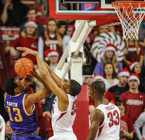 Arkansas Razorbacks forward Keaton Miles (55) blocks the shot of Tennessee Tech Golden Eagles forward Ryan Martin (13) during a basketball game between Arkansas and Tennessee Tech on December 12, 2015.    (Alan Jamison, Nate Allen Sports Service)