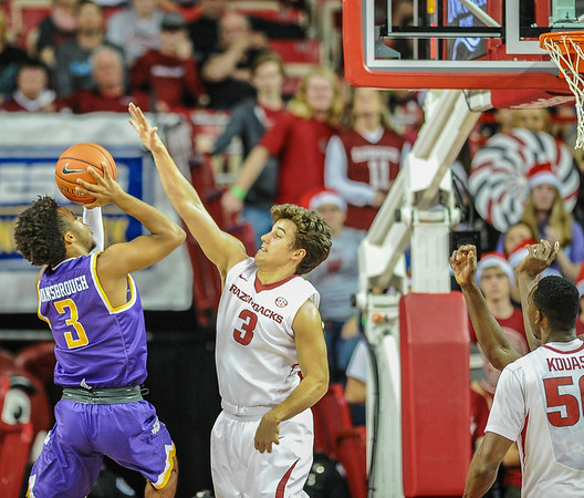 Arkansas Razorbacks guard Dusty Hannahs (3) guards Tennessee Tech Golden Eagles guard Tre Hansbrough (3) during a basketball game between Arkansas and Tennessee Tech on December 12, 2015.    (Alan Jamison, Nate Allen Sports Service)
