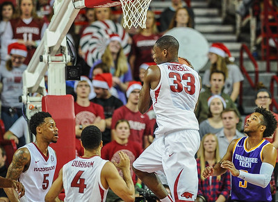 Arkansas Razorbacks forward Moses Kingsley (33) with a rebound during a basketball game between Arkansas and Tennessee Tech on December 12, 2015.    (Alan Jamison, Nate Allen Sports Service)