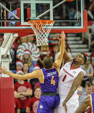 Arkansas Razorbacks forward Trey Thompson (1) blocks the shot of Tennessee Tech Golden Eagles guard Aleksa Jugovic (4) during a basketball game between Arkansas and Tennessee Tech on December 12, 2015.    (Alan Jamison, Nate Allen Sports Service)