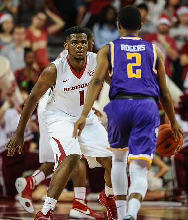Arkansas Razorbacks forward Trey Thompson (1) guards Tennessee Tech Golden Eagles guard Hakeem Rogers (2) during a basketball game between Arkansas and Tennessee Tech on December 12, 2015.    (Alan Jamison, Nate Allen Sports Service)