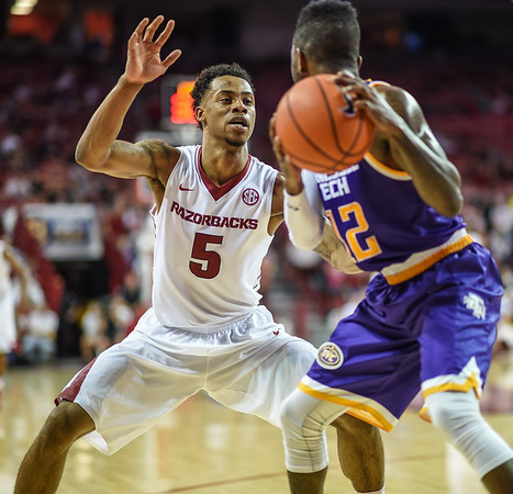 Arkansas Razorbacks guard Anthlon Bell (5) defends Tennessee Tech Golden Eagles guard Torrance Rowe (12) during a basketball game between Arkansas and Tennessee Tech on December 12, 2015.    (Alan Jamison, Nate Allen Sports Service)