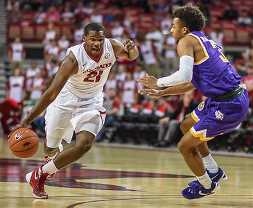 Arkansas Razorbacks guard Manuale Watkins (21) drives during a basketball game between Arkansas and Tennessee Tech on December 12, 2015.    (Alan Jamison, Nate Allen Sports Service)