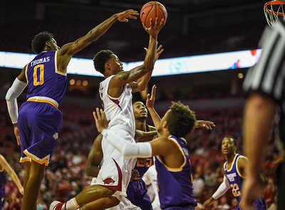 Arkansas Razorbacks guard Anthlon Bell (5) shoots during a basketball game between Arkansas and Tennessee Tech on December 12, 2015.    (Alan Jamison, Nate Allen Sports Service)