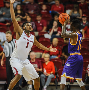 Arkansas Razorbacks forward Trey Thompson (1) guards Tennessee Tech Golden Eagles guard Torrance Rowe (12) during a basketball game between Arkansas and Tennessee Tech on December 12, 2015.    (Alan Jamison, Nate Allen Sports Service)