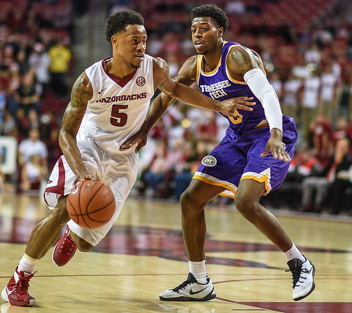 Arkansas Razorbacks guard Anthlon Bell (5) drives during a basketball game between Arkansas and Tennessee Tech on December 12, 2015.    (Alan Jamison, Nate Allen Sports Service)