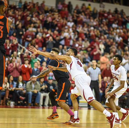 Arkansas Razorbacks guard Jabril Durham (4) presses during a basketball game between Arkansas and Mercer on December 19, 2015.    (Alan Jamison, Nate Allen Sports Service)