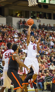 Arkansas Razorbacks guard Anthlon Bell (5) with a shot during a basketball game between Arkansas and Mercer on December 19, 2015.    (Alan Jamison, Nate Allen Sports Service)