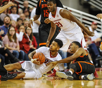Arkansas Razorbacks guard Anton Beard (31) ties up a loose ball during a basketball game between Arkansas and Mercer on December 19, 2015.    (Alan Jamison, Nate Allen Sports Service)