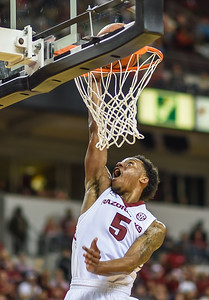Arkansas Razorbacks guard Anthlon Bell (5) with a fast break during a basketball game between Arkansas and Mercer on December 19, 2015.    (Alan Jamison, Nate Allen Sports Service)