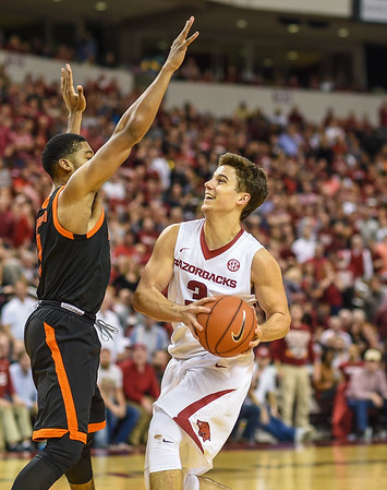 Arkansas Razorbacks guard Dusty Hannahs (3) drives to the basket during a basketball game between Arkansas and Mercer on December 19, 2015.    (Alan Jamison, Nate Allen Sports Service)