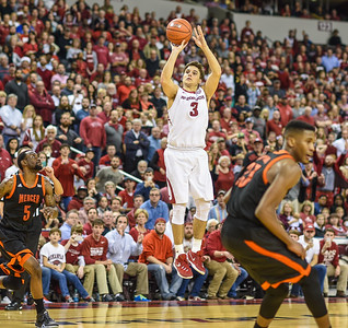 Arkansas Razorbacks guard Dusty Hannahs (3) shoots for three during a basketball game between Arkansas and Mercer on December 19, 2015.    (Alan Jamison, Nate Allen Sports Service)