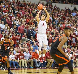 Arkansas Razorbacks guard Dusty Hannahs (3) shoots for three during a basketball game between Arkansas and Mercer on December 19, 2015.    (Alan Jamison, Nate Allen Sports Service)