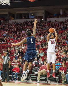 Arkansas Razorbacks forward Keaton Miles (55) with a shot during a basketball game between Arkansas and North Florida on December 22, 2015.    (Alan Jamison, Nate Allen Sports Service)
