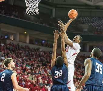 Arkansas Razorbacks center Willy Kouassi (50) shoots during a basketball game between Arkansas and North Florida on December 22, 2015.    (Alan Jamison, Nate Allen Sports Service)
