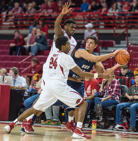 Arkansas Razorbacks guard Jimmy Whitt (24) and Arkansas Razorbacks forward Trey Thompson (1) trap North Florida Ospreys guard Aaron Bodager (12) during a basketball game between Arkansas and North Florida on December 22, 2015.    (Alan Jamison, Nate Allen Sports Service)