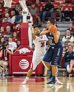 Arkansas Razorbacks guard Anton Beard (31) defends against North Florida Ospreys guard Aaron Bodager (12) during a basketball game between Arkansas and North Florida on December 22, 2015.    (Alan Jamison, Nate Allen Sports Service)
