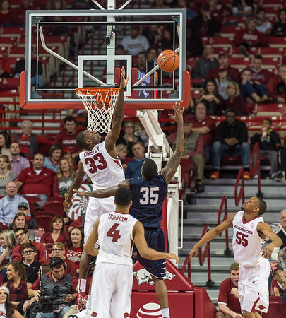 Arkansas Razorbacks forward Moses Kingsley (33) swats at the ball during a basketball game between Arkansas and North Florida on December 22, 2015.    (Alan Jamison, Nate Allen Sports Service)