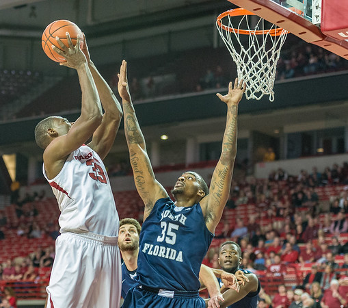 Arkansas Razorbacks forward Moses Kingsley (33) goes up for a shot against North Florida Ospreys forward Chris Davenport (35) during a basketball game between Arkansas and North Florida on December 22, 2015.    (Alan Jamison, Nate Allen Sports Service)